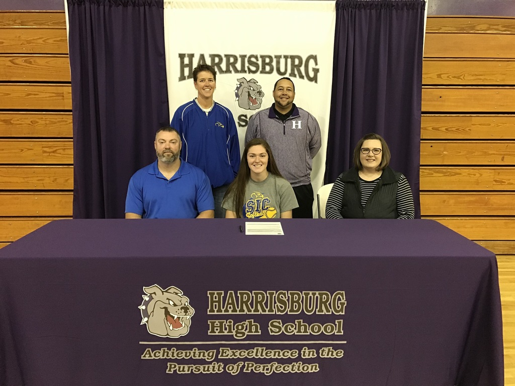Congratulations to Mya King on her signing to play softball at SIC. Back row L-R: SIC head coach Maggie Calcaterra, assistant softball coach Jake Stewart. at table L-R: dad Jake King, Mya King, mom Jennifer King.