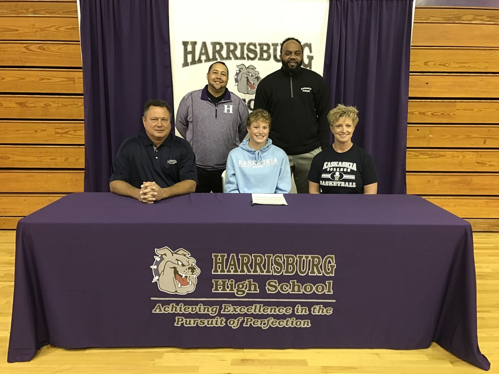 Congratulations to Lauren McDaniel on her signing to play basketball and soccer at Kaskaskia College. Back row: Head Basketball Kaskaskia College Coach Jenkins, Head HHS Basketball Coach Jake Stewart. At table L-R:  dad Kenny McDaniel, Lauren McDaniel, mom JJ McDaniel.